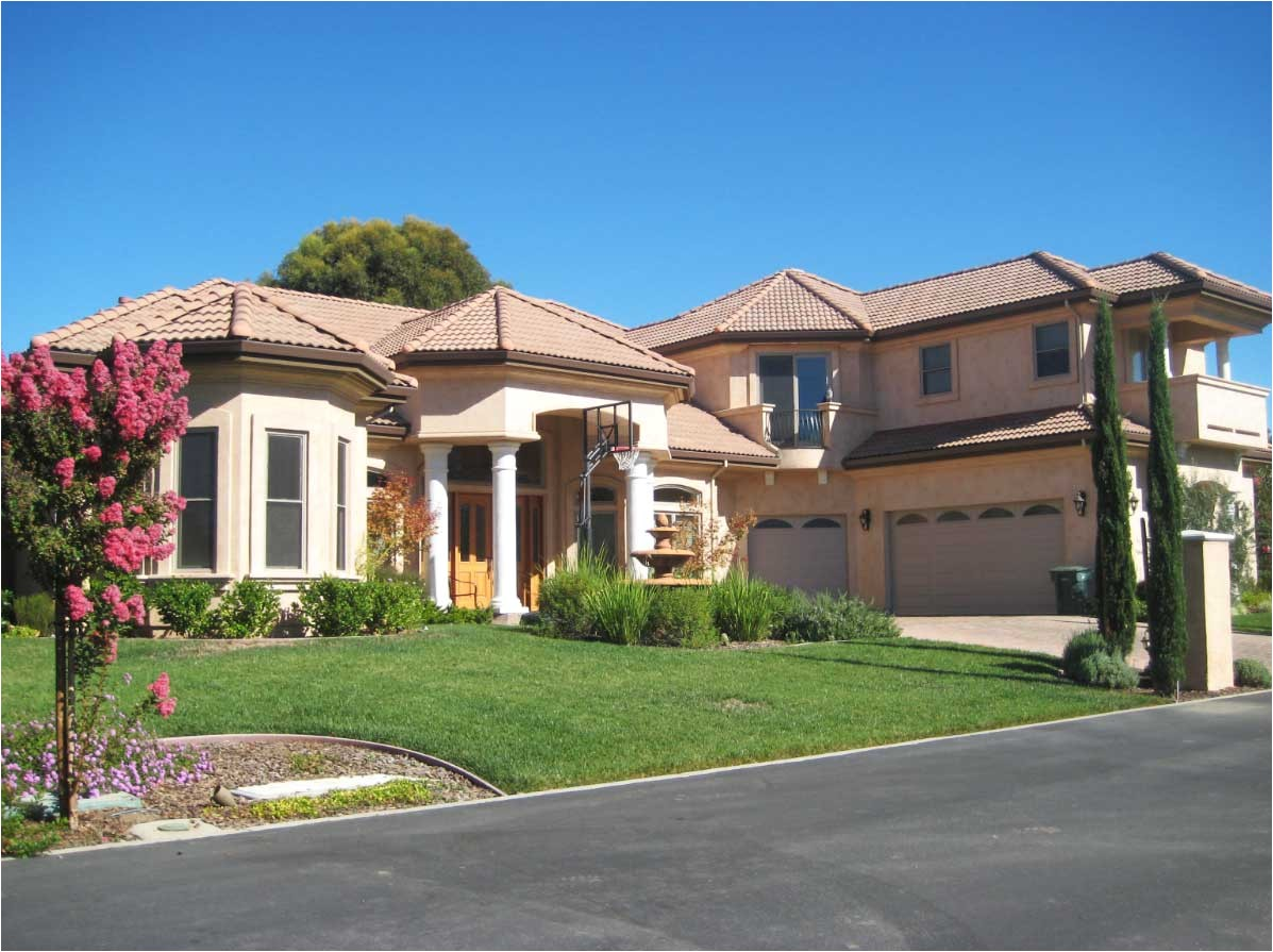 awesome custom design homes with front garden with cream wall paint color and with clay roof tile
