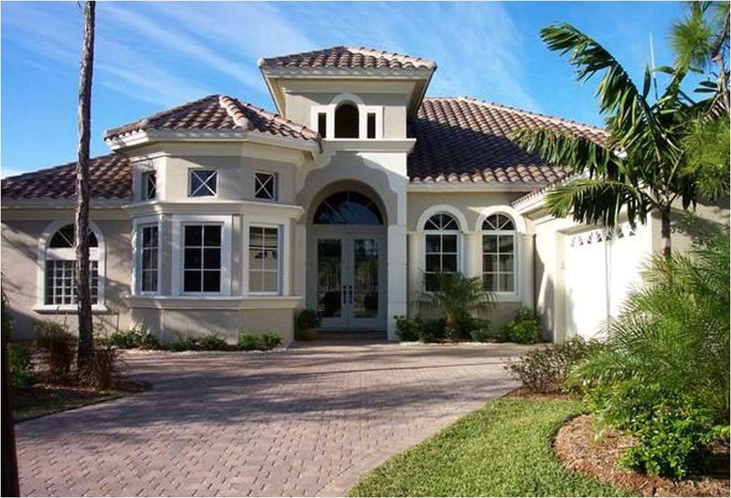 awesome mediterranean home design with cream wall paint color ideas combine with orange clay roof tile complete with the palm tree