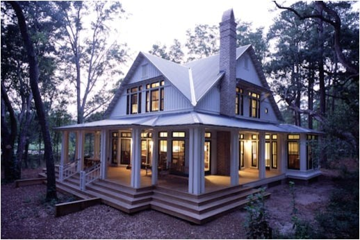 like the wrap around porch with glass doors windows all the way around
