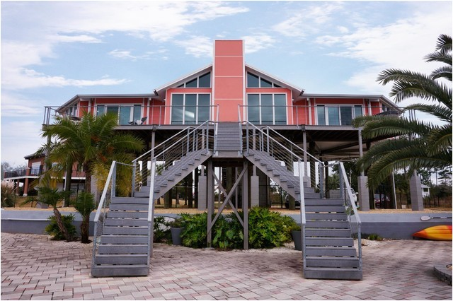 elevated hurricane proof home on pilings stilts beach style exterior new orleans