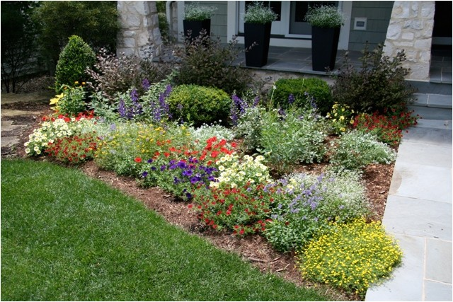 flower bed next to house foundation