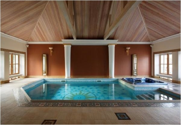 small indoor swimming pool design with wooden roof design
