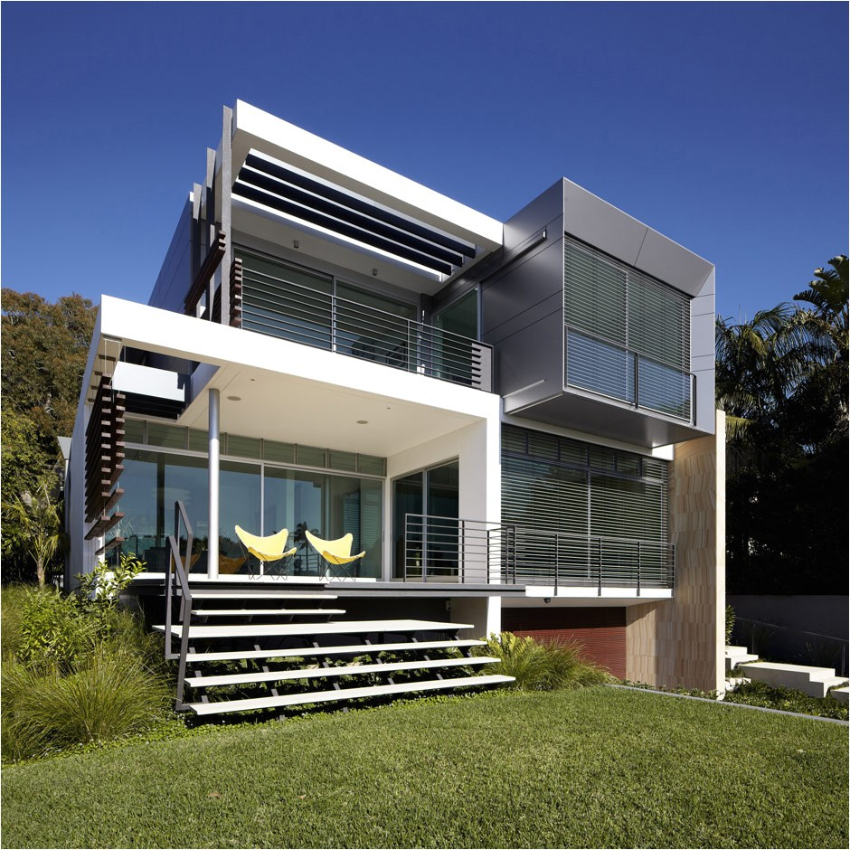 house with outdoor spiral staircase leading to rooftop deck