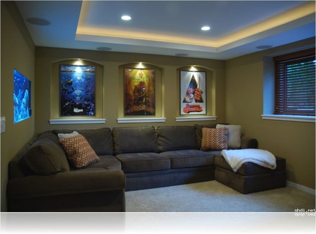 alluring small home theater room ideas l shape grey sectional sofa green painted wall cool wall movie poster recessed wall lamp vertical window blinds recessed ceiling lamp