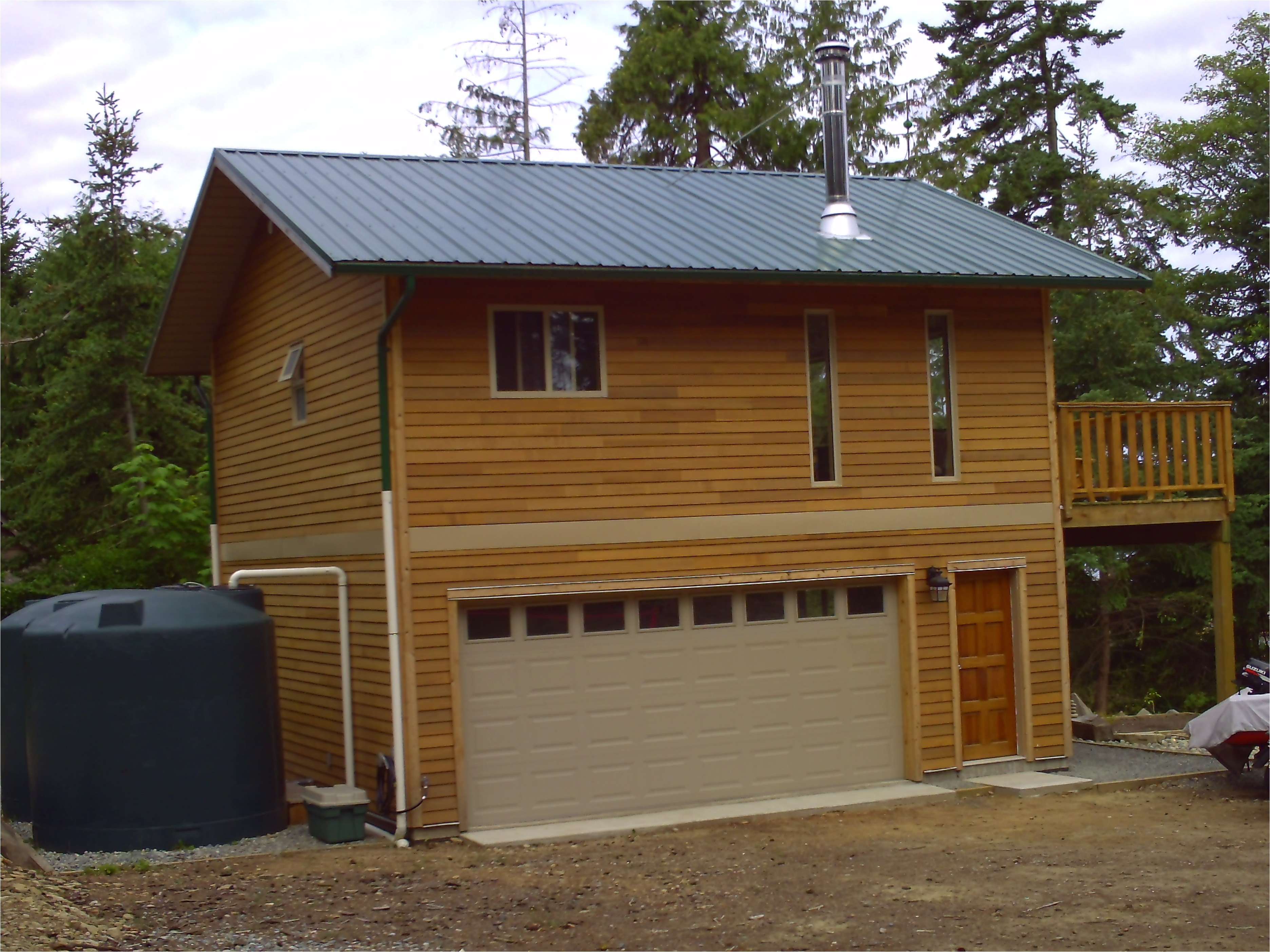wonderful loft small houses with sloped roofing as well as wide sliding garage doors as inspiring traditional tiny house designs