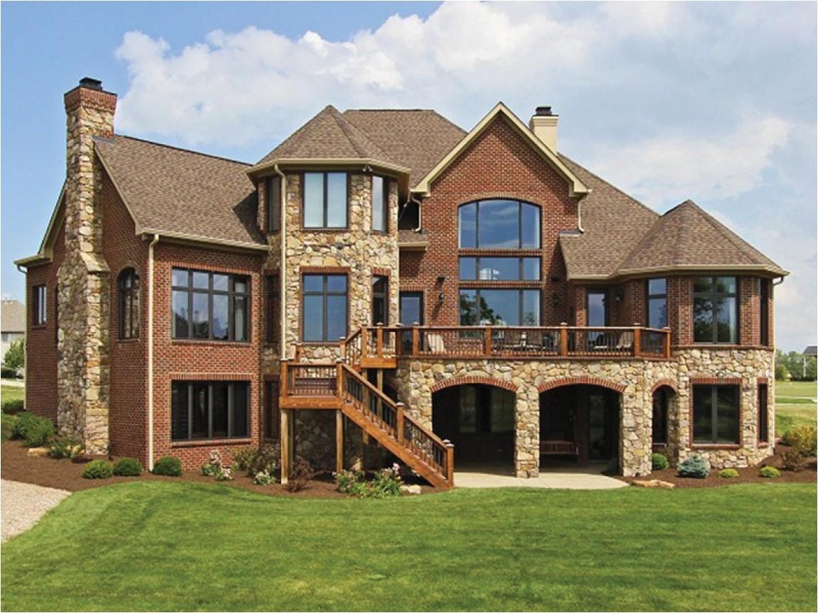 4490e38263e7140f blue brick house houses with brick and stone
