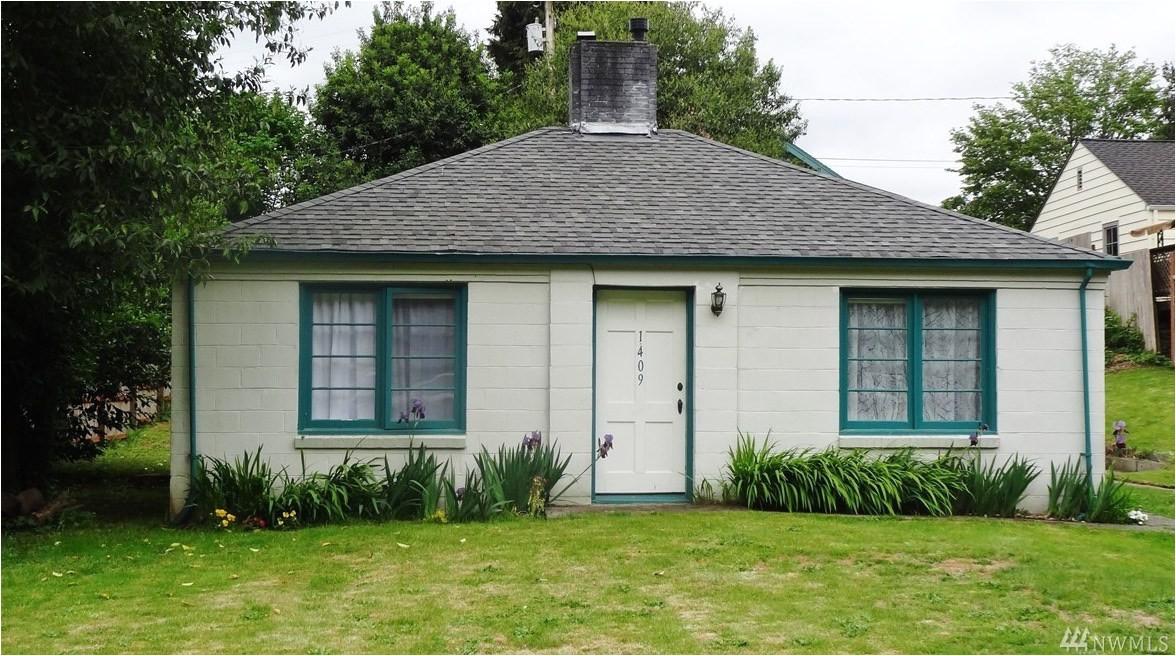 historical 720 sq ft cinder block cottage for sale