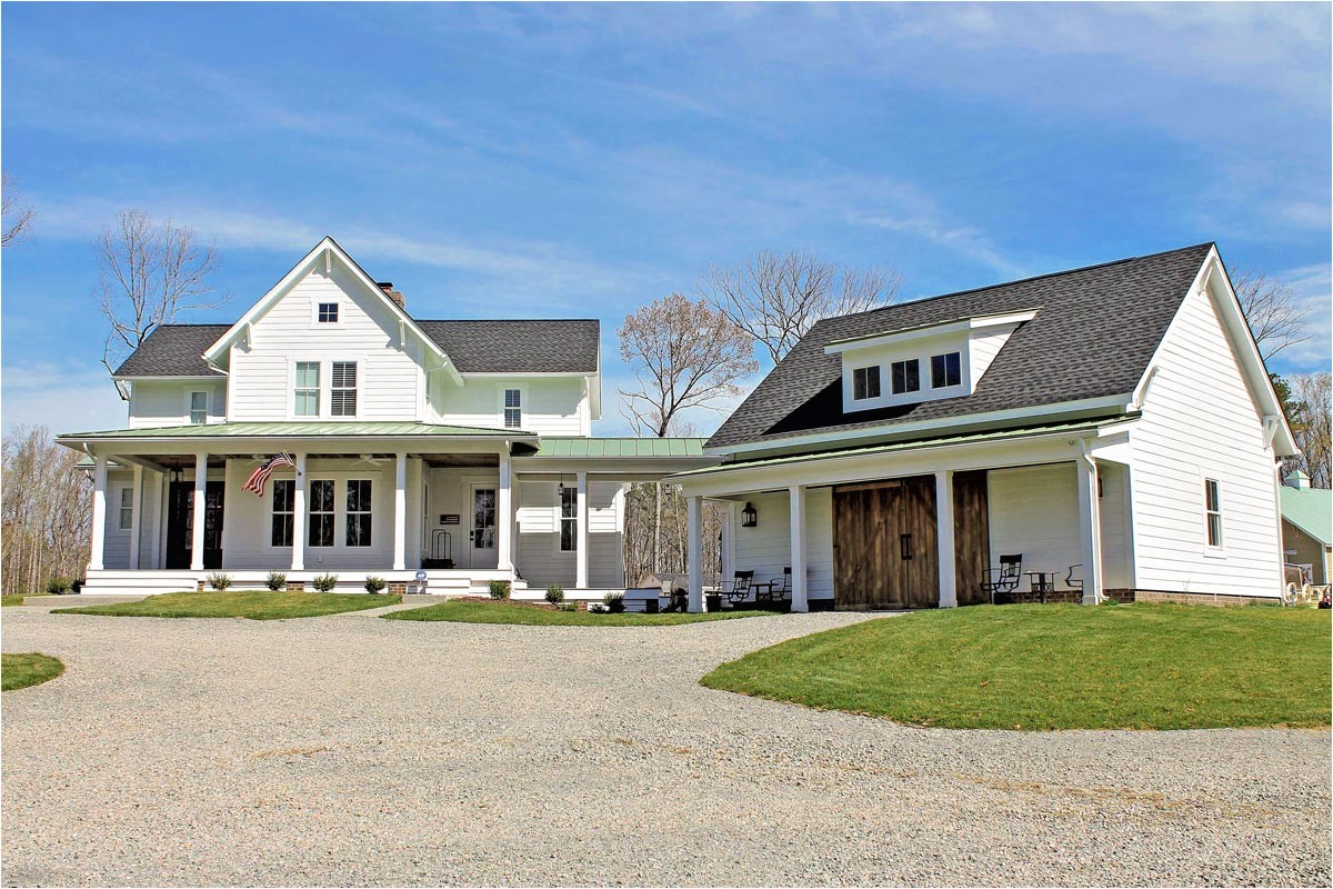 quintessential american farmhouse with detached garage and breezeway 500018vv