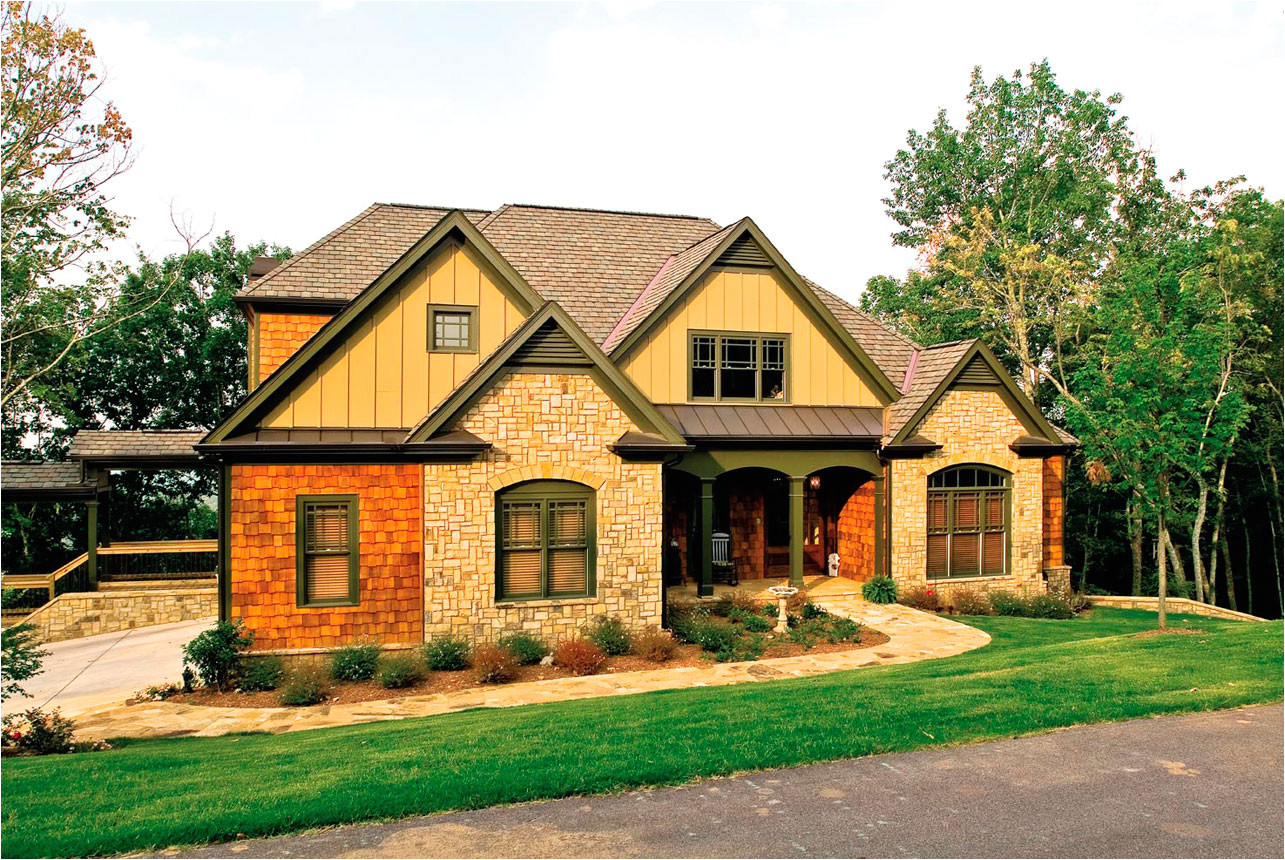 exterior frank betz house plans design with single hung window and stone wall accent plus weathered wood roof design