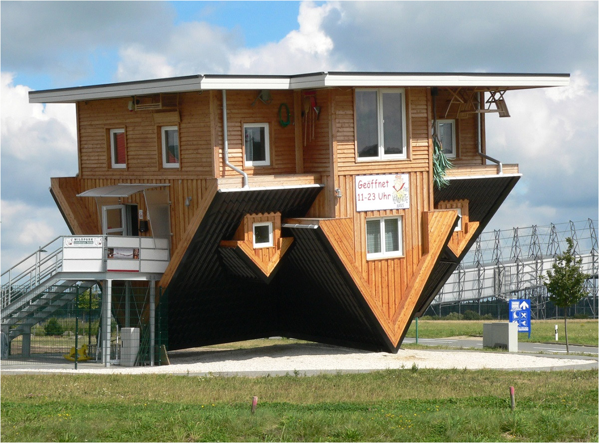 unique inverted architectural house design with wooden wall exterior ideas