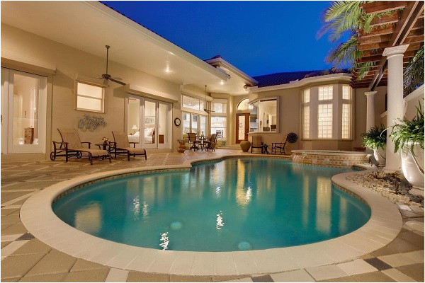 luxury homes in florida with unique swimming pools