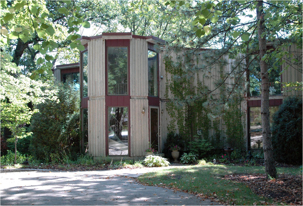 a poured concrete house in the woods