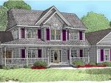 Corner Lot House Plans with Side Load Garage This House Plan Features A Fireplace Built Ins Foyer