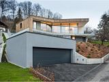 House Plans On Hill Slopes 3 Storey Home On Steep Slope with Grass Roofed Garage