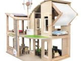 Plan toys Doll Houses Amazon Com Plan toys the Green Dollhouse with Furniture
